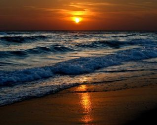 sunset over waves