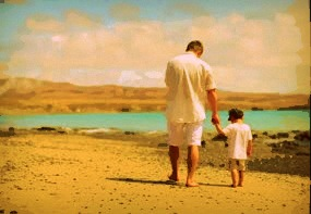 stock-footage-little-boy-with-father-walking-along-the-beach copy